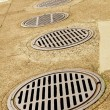 Line up of Sewer Drains — Stock Photo