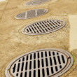 Stock Photo: Line up of Sewer Drains