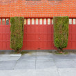 Three Red Garages - Stock Photo