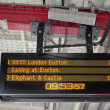 Electronic Timetable on London Railway Platform with Security Ca — Stock fotografie