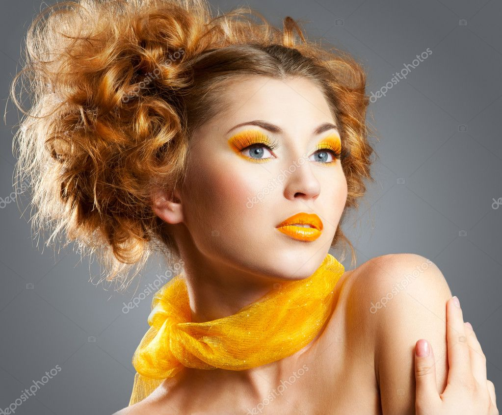 Beautiful woman with bright creative yellow makeup and curly hairstyle  Stock Photo #10229355