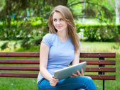 Girl with tablet pc — Stock Photo