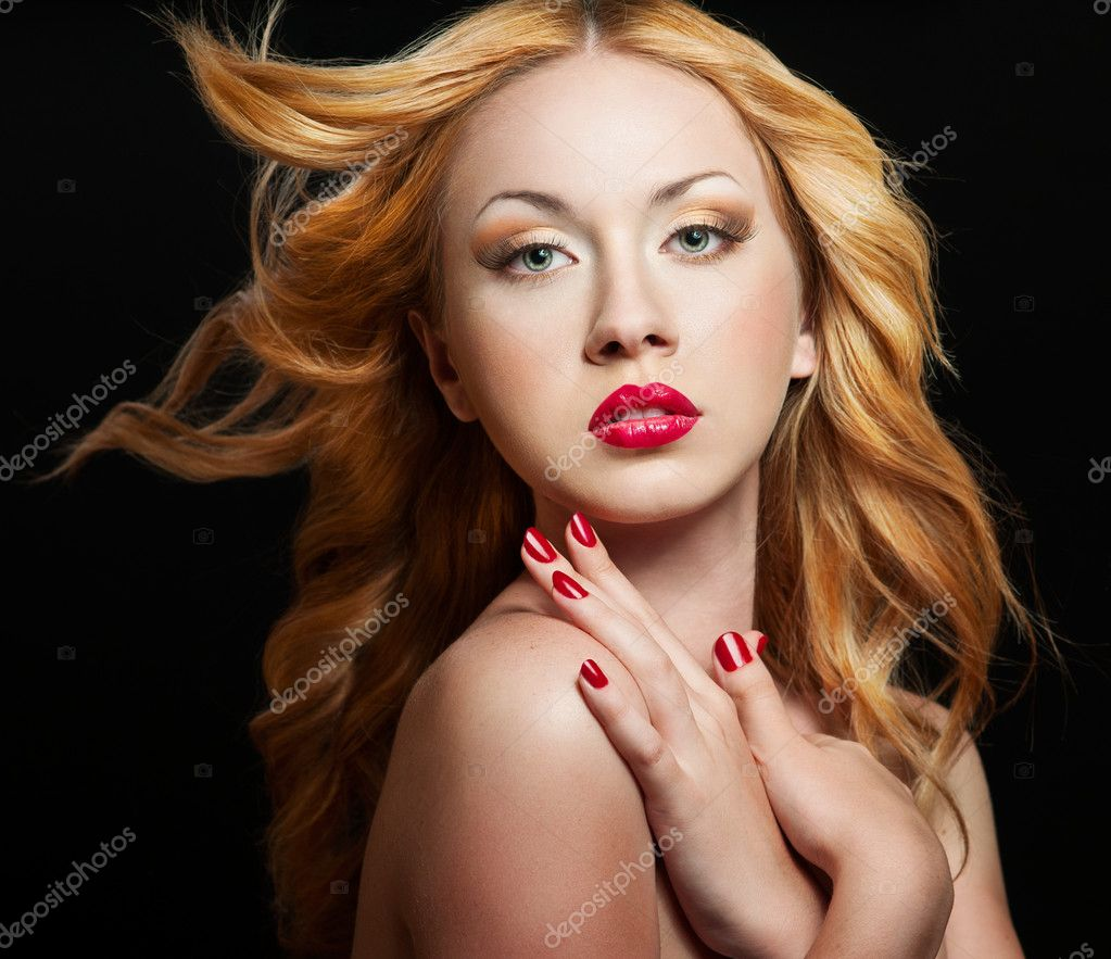 Beautiful woman with bright red lips and manicure and curly hair  Stock Photo #10681822