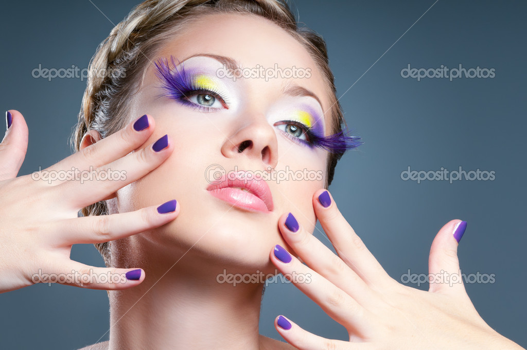 Woman face with bright violet makeup and manicure  Stock Photo #8064081