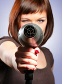 Woman with hairdryer — Stock Photo