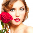 Woman with red rose — Stockfoto