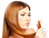Woman holding split ends — Stockfoto