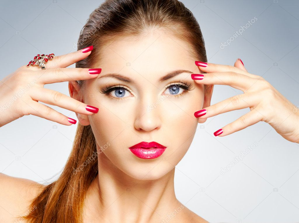 Beautiful girl with bright red lips and manicure  Stock Photo #9763043