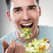 Stock Photo: Eating salad