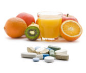 Pills and fruits — Stock Photo