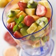 Fruit in blender - Stock Photo