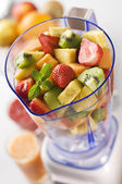 Fruit in blender — Stock Photo