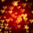 Stock Photo: Golden red hearts background