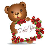 Brown Teddy bear with greeting card — Stock Photo