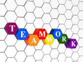 Teamwork in colour hexahedrons in cellular structure — Stock Photo