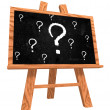 Stock Photo: Blackboard with question signs