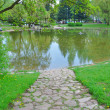 Stone road to a pond — Stock Photo