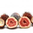 Exotic fruits compilation: rambutan and fig — Stock Photo