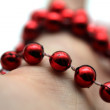 Hand with red pearls — Stock Photo