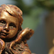 Foto Stock: Bronze cherub face decoration
