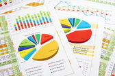 Sales Report in Digits, Graphs and Charts — Stock Photo