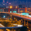 Highway traffic in city at night — Stock Photo