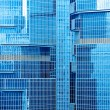 Abstract texture of blue glass modern building skyscrapers — Stock Photo #10677543
