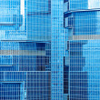 Abstract texture of blue glass modern building skyscrapers — Stock Photo