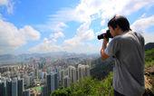 Photographer take photo of city — Stock Photo