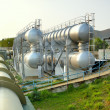 Oil tanks and pipes outdoor at day — Stock Photo