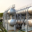 Stock Photo: Oil tanks and pipes outdoor at day