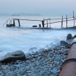 Old metal pipe and road to sea — Stock Photo #8153716