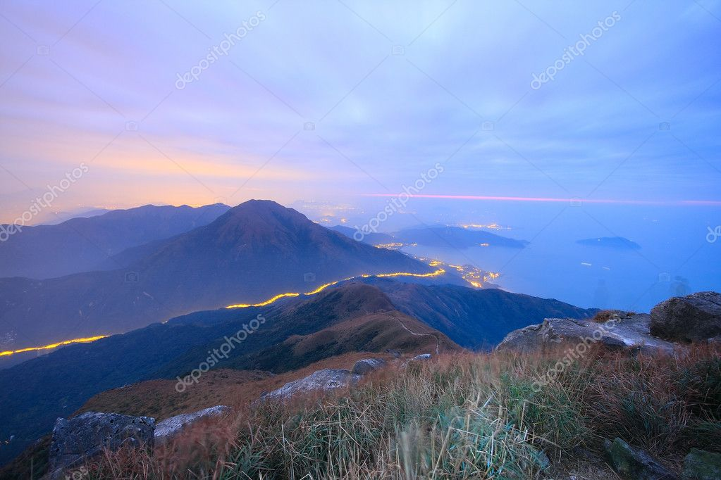 Dark landscape with fog between hills and orange sky before sunrise — Stock Photo #8153529