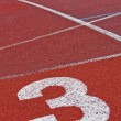 Running track numbers one two three in stadium — Stock Photo #8610849