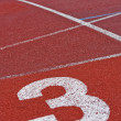 Stock Photo: Running track numbers one two three in stadium