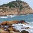 Rocky sea coast and blurred water in shek o,hong kong — Stock Photo #8610983