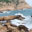 Rocky sea coast and blurred water in shek o,hong kong — Stock Photo #8610984