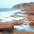 Rocky sea coast and blurred water in shek o,hong kong — Stock Photo #8610986