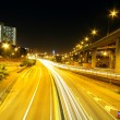 Highway at night in modern city — Stock Photo