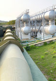 Oil tanks and pipes outdoor at day — Стоковое фото