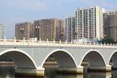 Arch bridge in asia downtown area, hong kong — Stock Photo
