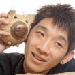 Asia man with piggy bank — Stock Photo
