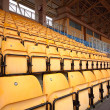 Plenty of yellow plastic seats at stadium — Stock Photo