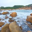 Rocky sea coast and blurred water in shek o,hong kong — Stock Photo