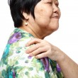Senior woman holding her aching back — Stock Photo