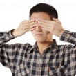 Portrait of a young man covering his eyes with hands — Stock Photo