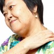 Senior womholding her aching back — Stock Photo #9467440