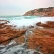 Rocky sea coast and blurred water in shek o,hong kong — Stock Photo #9467442