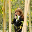 Beautiful asian woman using smart phone in the park - Stock fotografie