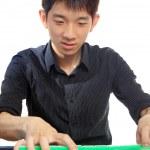 Chinese man play Mahjong, traditional China gamble. — Stock Photo